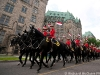 Mounties ride up Parliament Hill to perform the Musical Ride on Canada Day