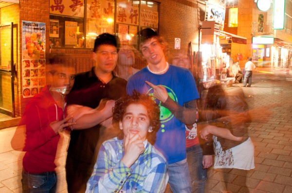 Young people in Chinatown, slow sync and ghosting